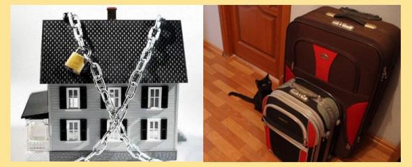 дом в догах и цепях и собранные у выхода чемоданы