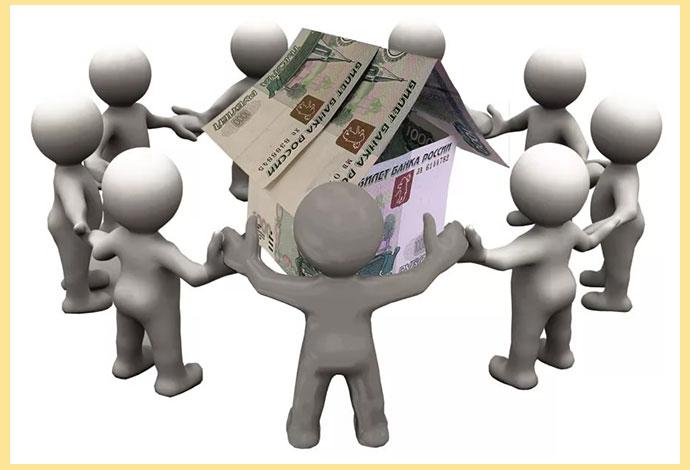 Люди в кругу вокург домика из денег